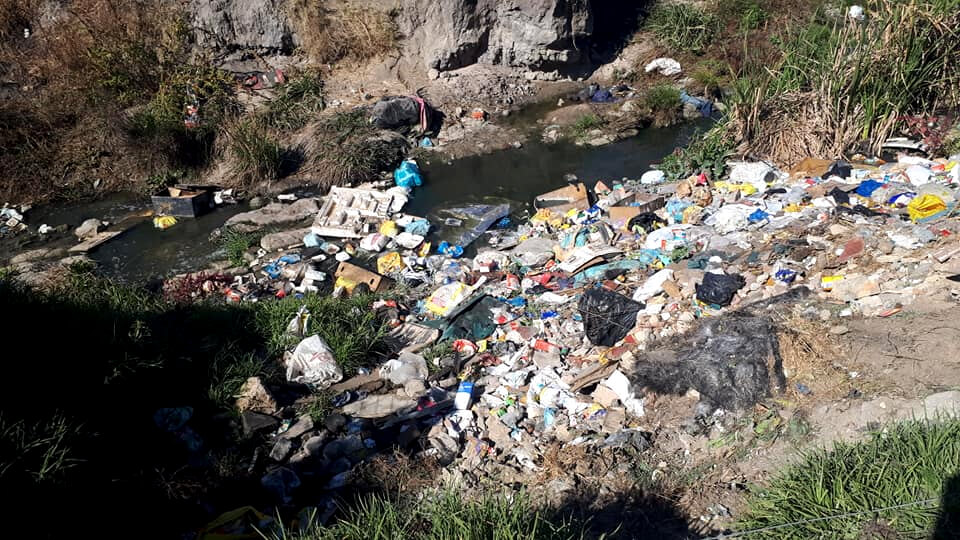The Hennops River filled with pollution and litter