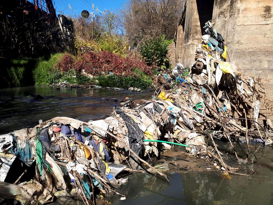 Trash flowing down the Hennops River - Centurion