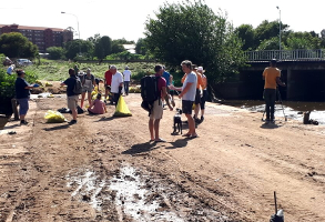 Normal people helping to change the polluted state of the Hennops River in Riverside Park